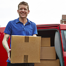 Man loading boxes in car